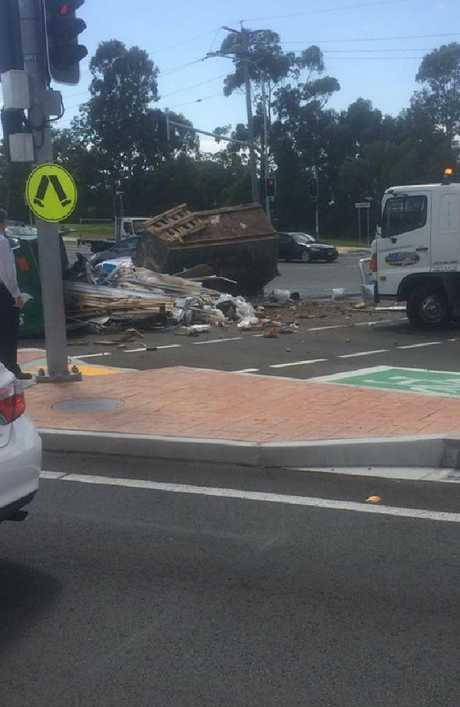 A truckload of debris has fallen across busy Ashmore Rd, Southport, Gold Coast. Photo: supplied