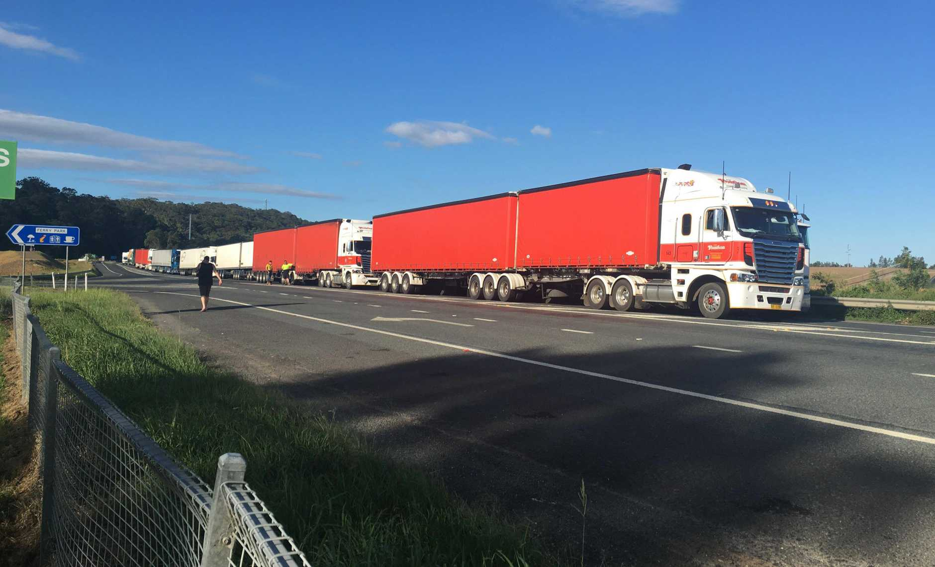 A long line of trucks await the re-opening of the Pacific Highway after the multi-vehicle accident.