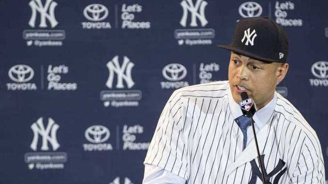 New Yankee Giancarlo Stanton answers questions during a press conference (AP Photo/Willie J. Allen Jr.)