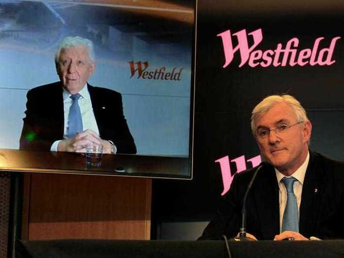 Westfield Corporation co-chief executive Steven Lowy (right) looks on as Westfield Corporation chairman Frank Lowy speaks to the media during a press conference in Sydney, Tuesday, December 12, 2017.  Photo: AAP