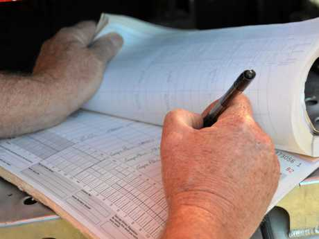 Truck driver fills out a log bookPhoto Carly Morrissey / Big Rigs