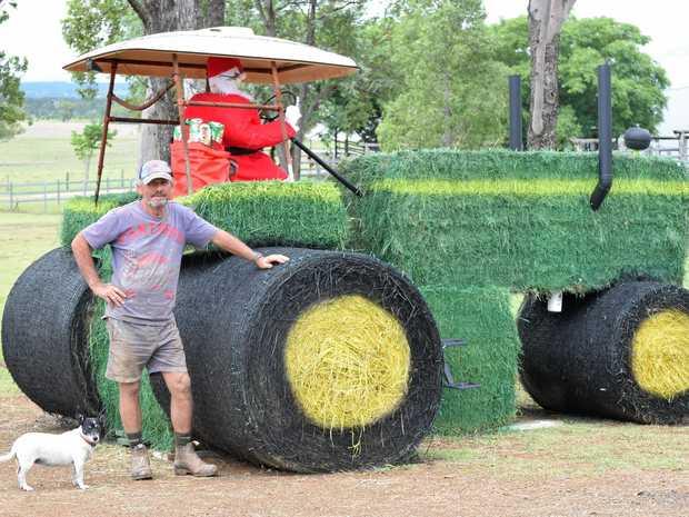 SANTA'S NEW RIDE: Jacko Bevan had the task of painting Santa's tractor in Mundubbera.