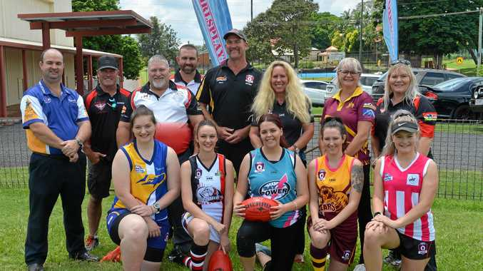 Players and club officials from Hervey Bay, Brothers, The Waves, Bay Power and Maryborough with outgoing AFL Wide Bay president Mark Mason.