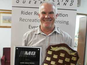 John Armstrong receives the Coach of the Year and Services in Coaching awards at Motorcycling Queensland's presentation night earlier this month.
