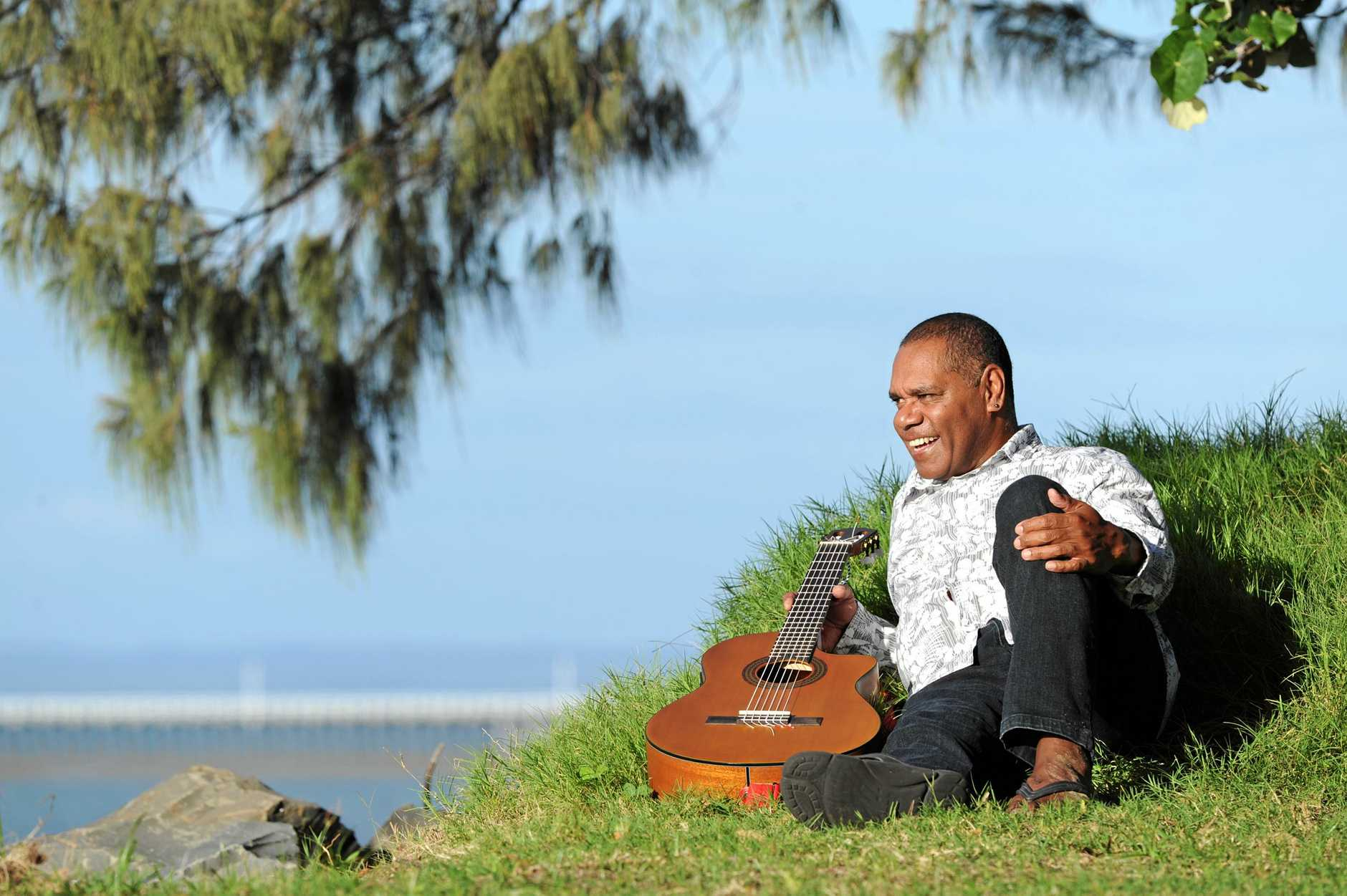 A couple of years after receiving Aboriginal Health Worker of the Year, John Corowa is enjoying a seachange which includes the 4 M's, music, Massage, markets and mowing.  Photo: Robyne Cuerel / Fraser Coast Chronicle
