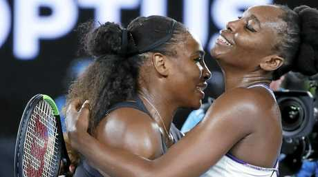 Serena Williams (left), embraces her sister Venus after winning the women's singles final at the 2017 Australian Open.