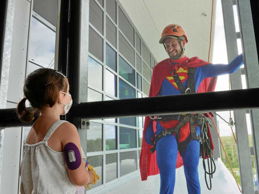 DROPPING IN: Super heroes descended on Sunshine Coast University Hospital to bring some cheer to the children's ward.