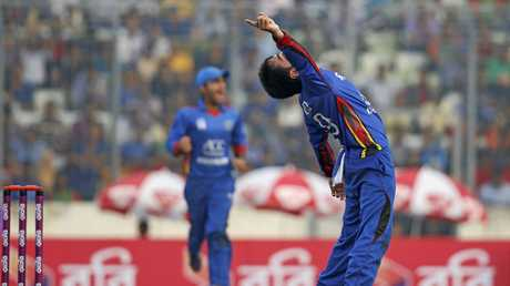 Afghanistan's Rashid Khan celebrates after claiming a wicket during a one-day international.