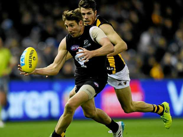 BIG VISIT: Carlton will hold an open training session this Sunday. Pictured is Dale Thomas in action.