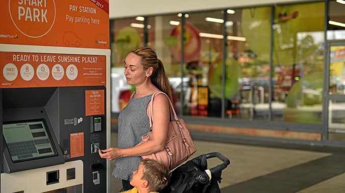 Genevieve Gresham and her son Owen at Smart Park pay station Sunshine Plaza.