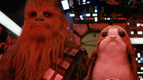 Chewbacca (Joonas Suotamo) and a Porg in a scene from the movie Star Wars: The Last Jedi. Supplied by Disney.