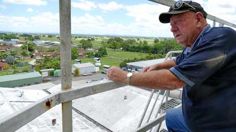 'This was all glistening white' says Les McGill looking over the damaged section of roof at the Grafton Brewery complex.
