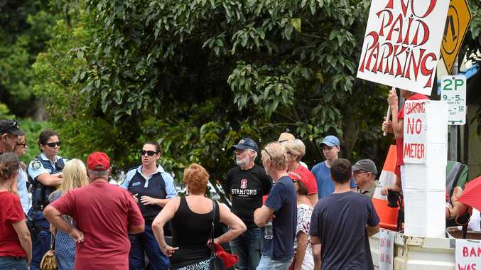 ANGRY RESIDENTS: Police talk to local residents protesting against paid parking in Bangalow.