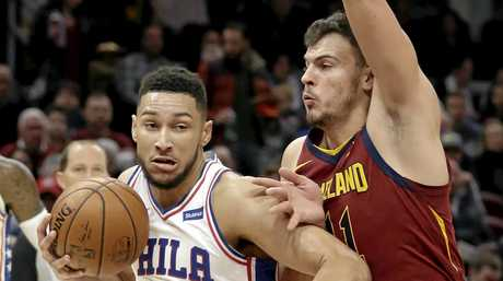 Ben Simmons drives against Cleveland Cavaliers defender Ante Zizic.