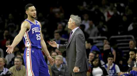 Ben Simmons (left) talks tactics with Philadelphia 76ers coach Brett Brown.