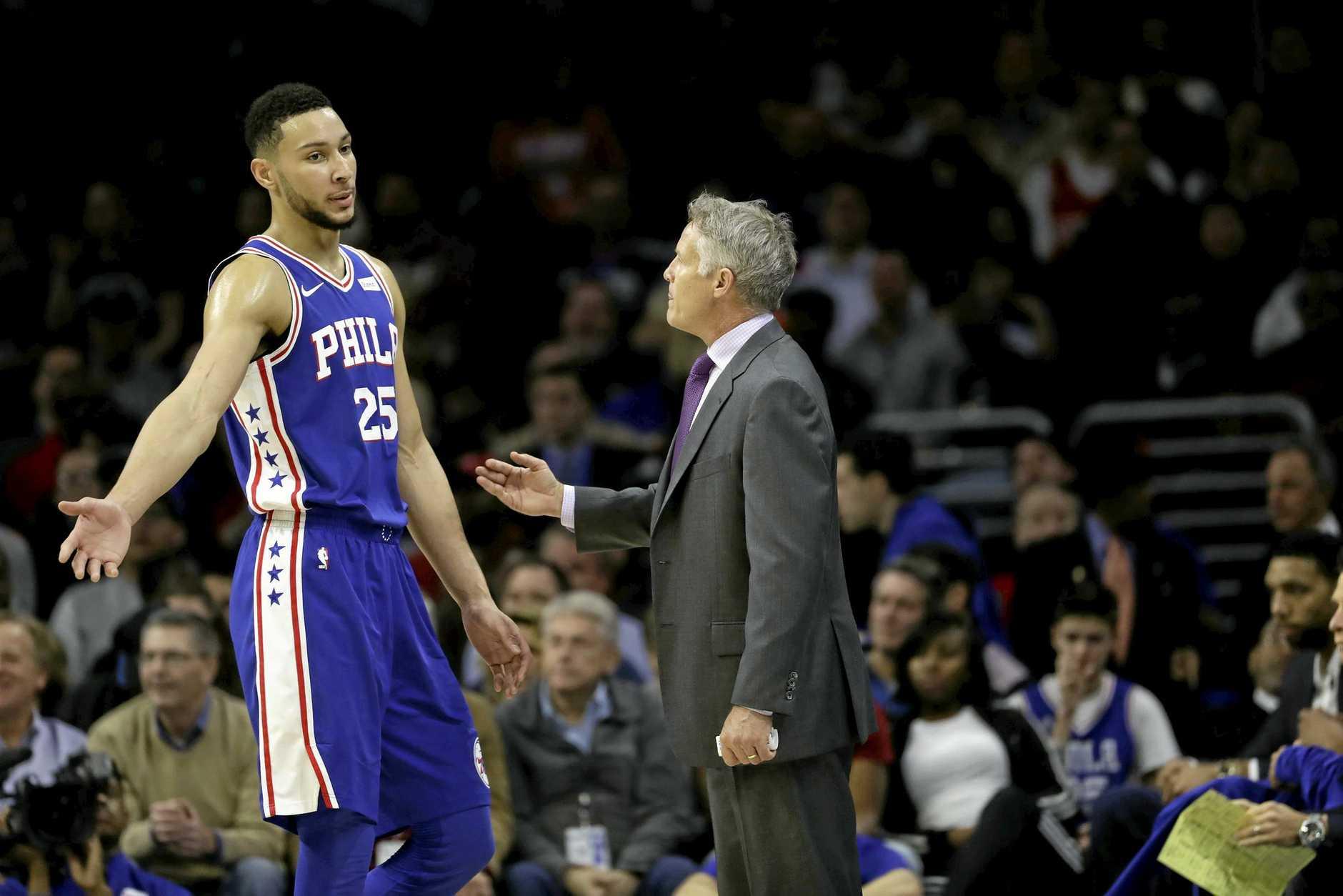 Philadelphia 76ers' Ben Simmons, left, talks with Brett Brown during an NBA basketball game against the Phoenix Suns, Monday, Dec. 4, 2017, in Philadelphia. (AP Photo/Matt Slocum)