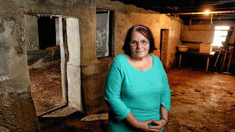 QCWA president Gaile Neville in what is belived to be an old jail under the building in Limestone Street.