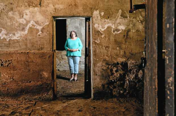 HISTORY: Country Women's Ipswich president Gail Neville in what is believed to be an old jail under the building in Limestone Street.