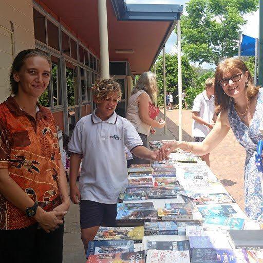 FUNDRAISING SUCCESS: Brianna Hanson with student Zac Croft and Mrs Van Egmond at the Burnside book swap.