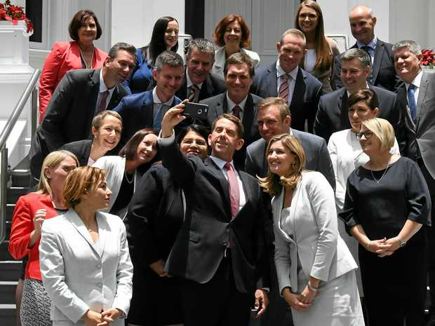 State Development Minister Cameron Dick (centre) takes a selfie with fellow ministers after a swearing in ceremony at Government House in Brisbane.