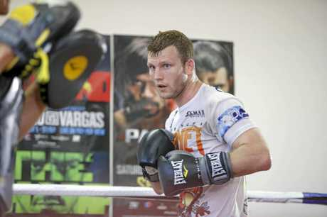 Jeff Horn hits the pads ahead of his title fight against Gary Corcoran.