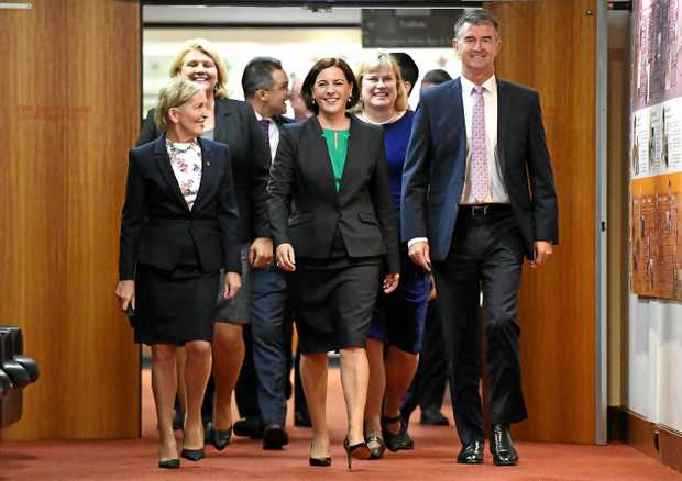 Queensland LNP leadership contender Deb Fracklington (centre), flanked by fellow party members Ros Bates (left) and Tim Mander, arrives at a party room meting at Parliament House in Brisbane, Tuesday, December 12, 2017. The LNP party room is meeting to choose a new leader after their recent state election loss. (AAP Image/Dan Peled) NO ARCHIVING