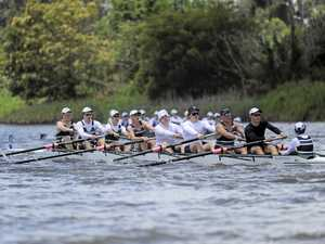 BEFORE THE STORM: Brisbane Boys College competes in the Champion Schoolboy Eight at the December Weekend of Rowing on the Clarence River on Friday .