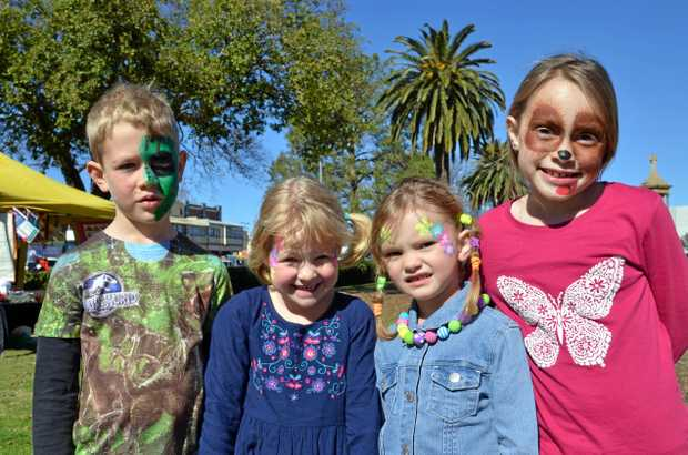 FUN DAY OUT: (From left) Oliver Fowler, 6, Lily Fowler, 4, Abigail May, 5 and Charlotte May, 9 get their faces painted.
