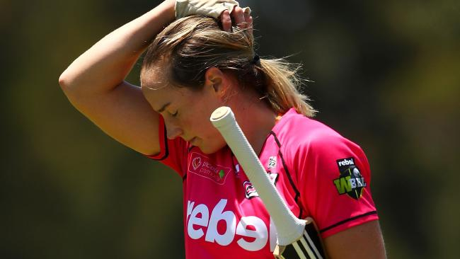 Sydney Sixers captain Ellyse Perry looks dejected after being dismissed. Pic: Getty Images)