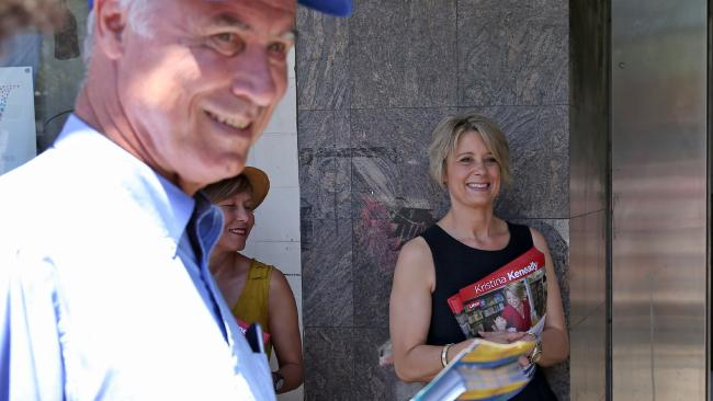 Mr Alexander and Ms Keneally hand out flyers outside the pre-polling office in Epping. Picture: Toby Zerna