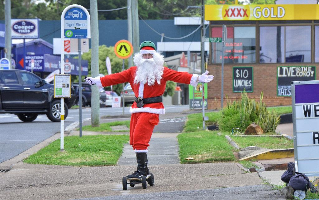 Santa cruising down Brisbane Street in West Ipswich on Wednesday.