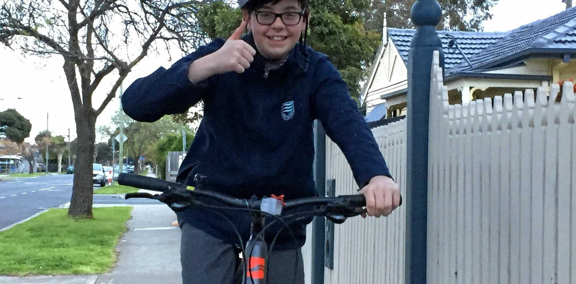 SAVED BY A TRUCKIE: Callum Simpson is back on his bike again after a heroic truckie saved him after a crash on a busy road.