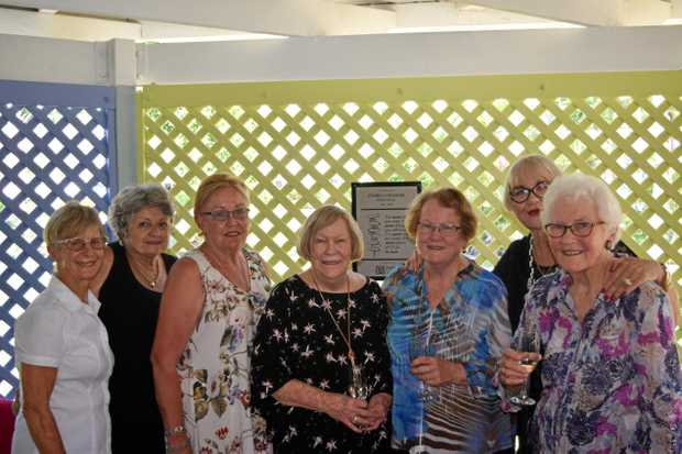 IN MEMORY: Pam's family and Zonta members with the plaque at Cannonvale State Primary School.