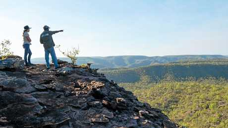 Lyndal Scobell of Cape York Natural Resource Management and Laura Land and Sea ranger Roderick Doughboy discuss land management issues at the Split Rock Escarpment overlooking the Kennedy Valley near Laura in Outback Queensland.