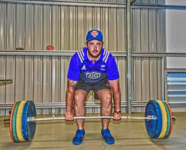 STEELY EYED: Grafton Redmen forward John Want working on his strength during pre-season training at Grafton High School.