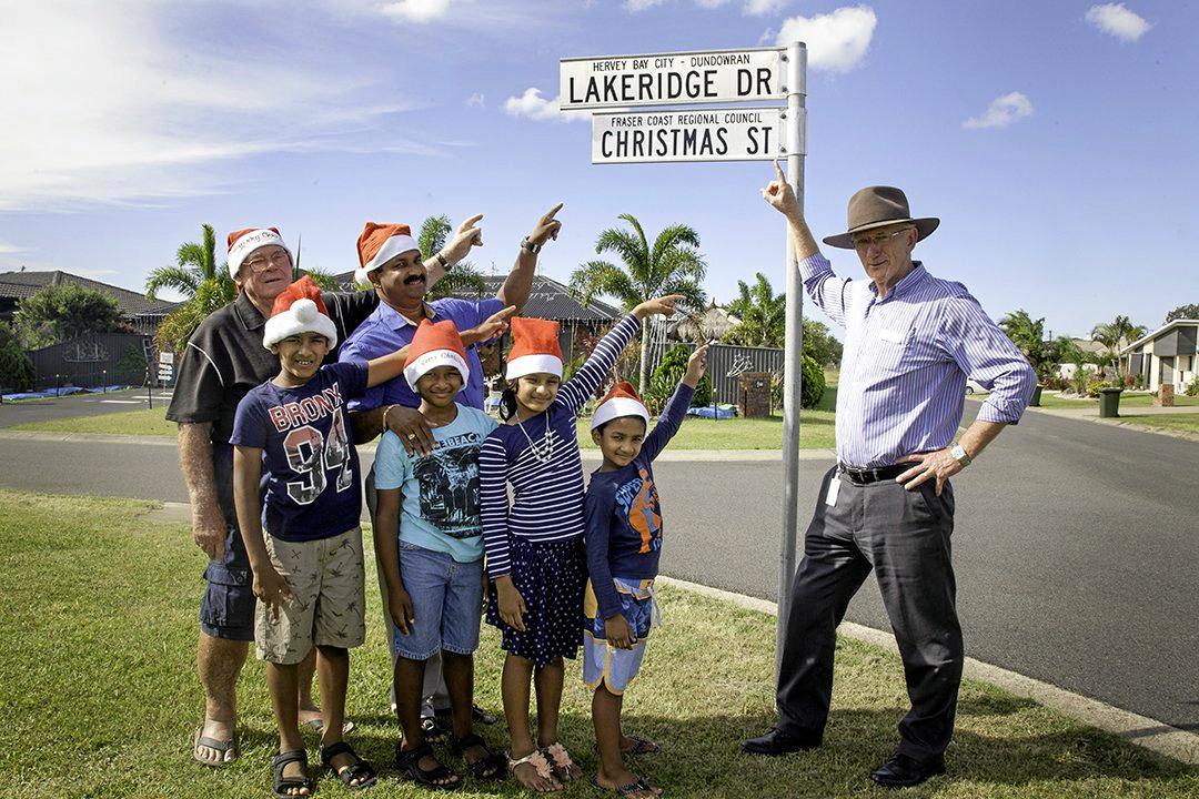 Fraser Coast Mayor Chris Loft (right) congratulates Christmas Street winners â€