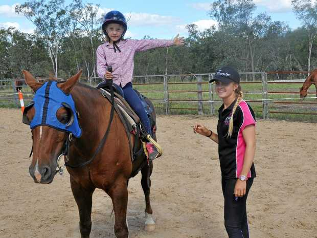 PASSING ON SKILLS: Horse trainer Breanna Cook loves seeing children gain confidence on horseback.