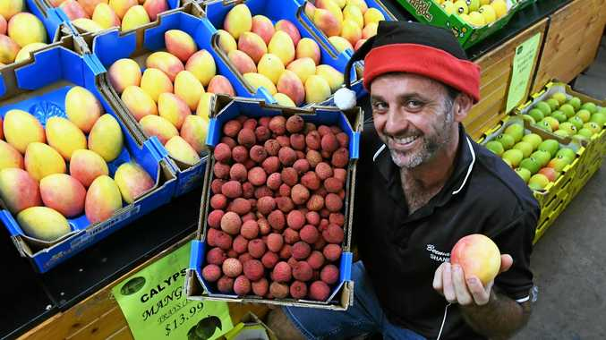 CHRISTMAS CHOICE: Beemart's Shane Olsen with lychees and mangoes, which are both good buys this Christmas.