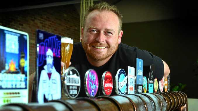GRAB A COLD ONE: Owner of The Dock Jared Hart at Mooloolaba Wharf with his line up of beers.
