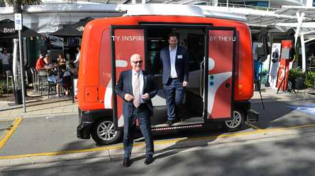 Mayor Mark Jamieson and Simon Pearce, from Easy Mile, step off a an electric, driverless shuttle in Mooloolaba.