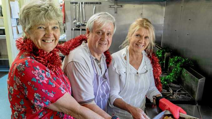 GIVING BACK: Mieke Bell with volunteers Ian and Jacky at The Winsome and Lismore Soup Kitchen.
