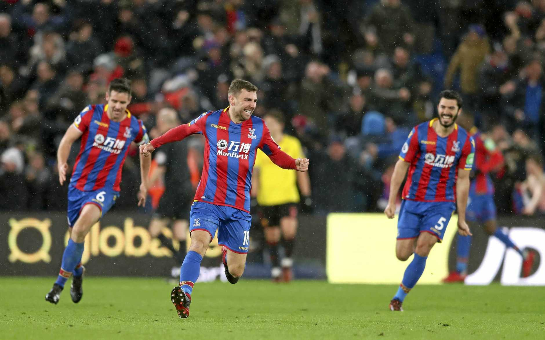 Crystal Palace's James McArthur, centre, celebrates scoring his side's late winner in the 2-1 victory over Watford.