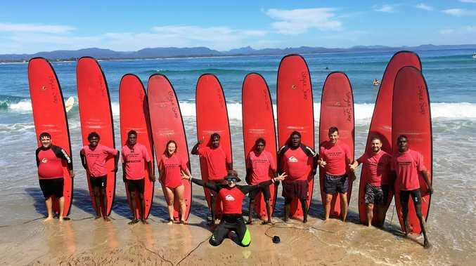 BIG DAY OUT: The Nhulunbuy Clontarf team with surfing coach Dan Emery.