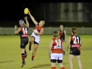 NEW ADDITIONS: South Toowoomba's Stacy Tindale (left) and Dalby's Shaye Easton compete for control of the ball. AFL Darling Downs has announced it will expand it's women's competition in 2018 with the addition of Coolaroo and University Cougars sides.