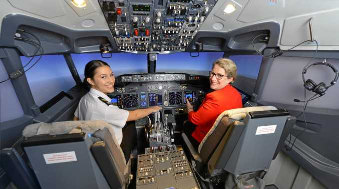 FLYING HIGH: First year aviation student Mardy Tritton with vice-chancellor Professor Geraldine MacKenzie in the new USQ Springfield Flight Simulator.