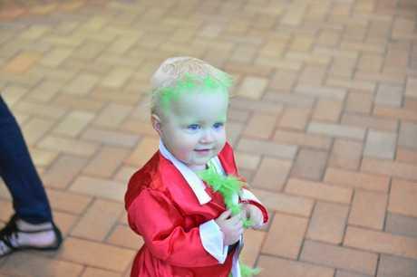 Little Hugo Barns makes a very cute Grinch.