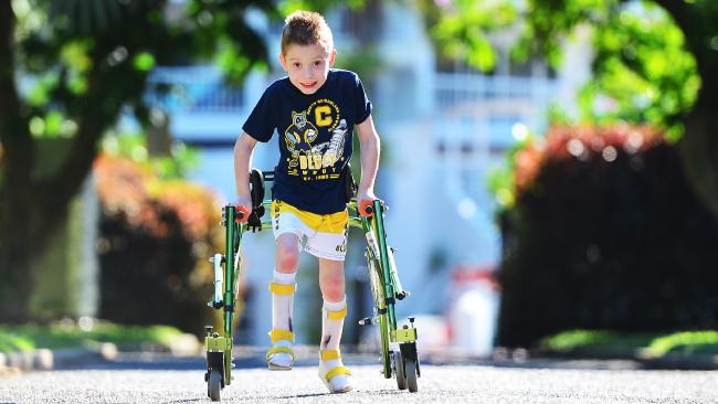 Cayleb Pinalli 7 of Burdell has cerebral palsy but isn't letting it slow him down as he is hopeful of one day walking without assistance. Picture: Zak Simmonds