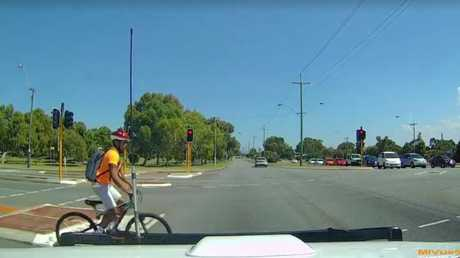 The cyclist starts to cross.