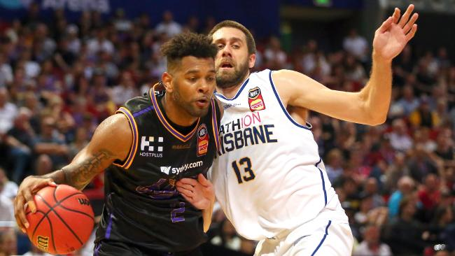 Jeremy Tyler of the Kings and Tom Jervis of the Bullets challenge for the ball during the Round 9 NBL match between the Sydney Kings and Brisbane Bullets at Qudos Bank Arena, Sydney, Saturday, December 9, 2017. Picture: AAP Image/Jeremy Ng.