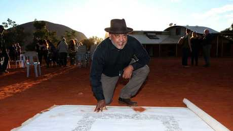 Noel Pearson signs the Uluru Statement which was dismissed out of hand by the government. (Pic: James Croucher)